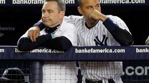 The Yankees' Derek Jeter puts his arm around