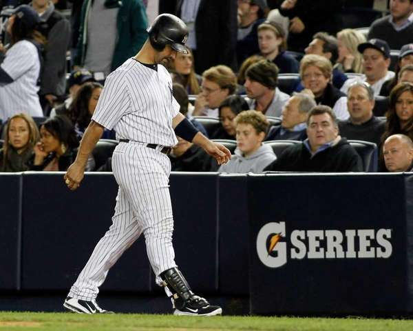 New York Yankees' Jorge Posada #20 walks back