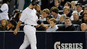 New York Yankees' Jorge Posada #20 walks back