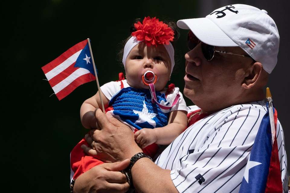 Hector Avila holds his granddaughter Rylee Rosado during