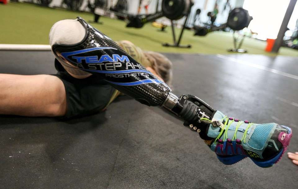 Amy Palmiero-Winters stretches at Crossfit Camo, in Farmingdale,