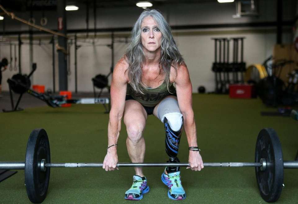 Amy Palmiero-Winters works out at Crossfit Camo, in