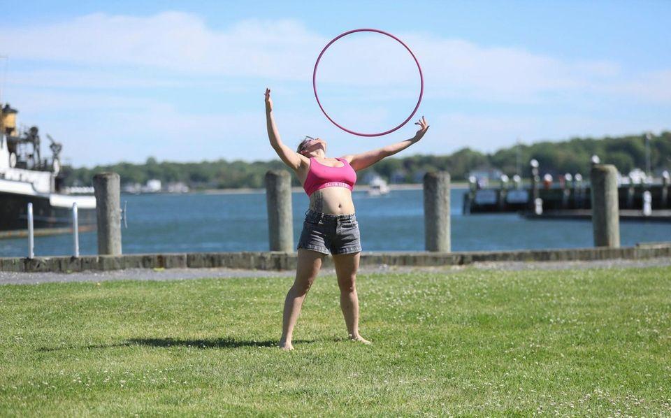 Veronica Davis practices her hoop dancing routines in