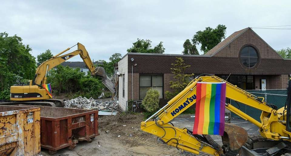 Demolition crews demolish the site of the former