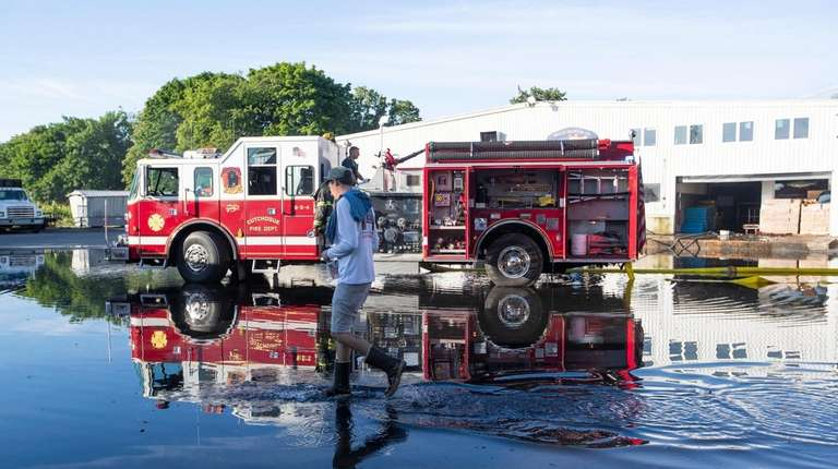 Firefighters at Braun Seafood Co. in Cutchogue on