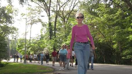 Sandra Gregorio, 71, of Hicksville, leads the way