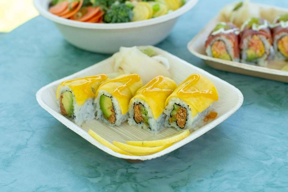The Vegan Sunset Roll is made with avocado,
