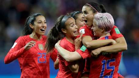 The United States' Alex Morgan, second right, celebrates