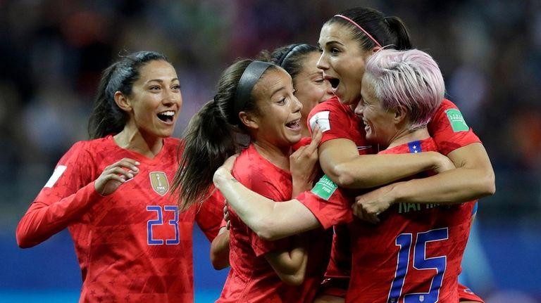 The United States' Alex Morgan, second right, celebrates