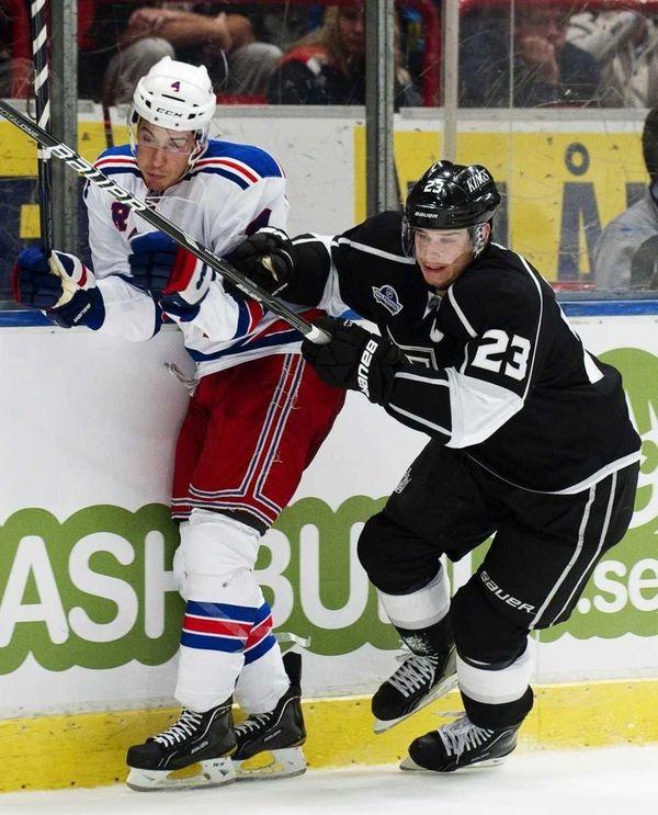 New York Rangers's Jeff Woywitka #4 gets body