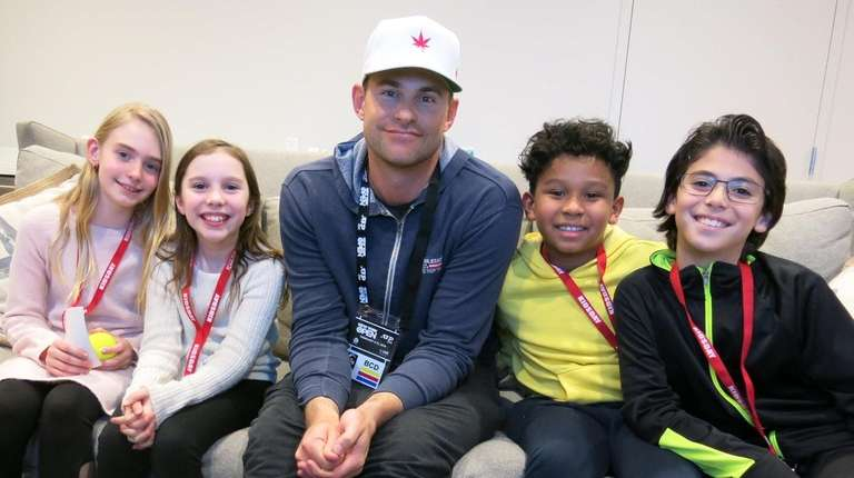 Tennis legend Andy Roddick with Kidsday reporters Ella