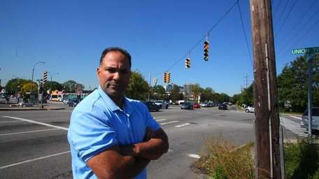 Frank Saladino stands by the intersection of Union