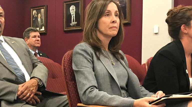 Suffolk police Commissioner Geraldine Hart, center, at the