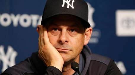 Manager Aaron Boone of the Yankees speaks to
