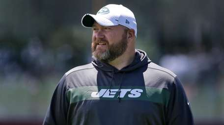 Jets general manager Joe Douglas watches during a