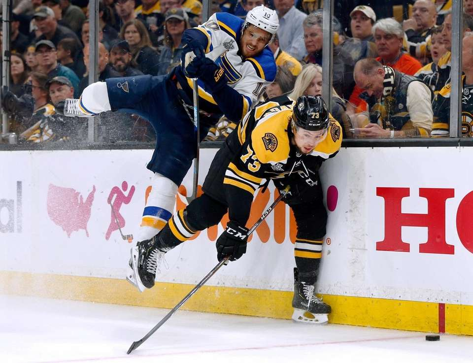 St. Louis Blues' Brayden Schenn, left, delivers a