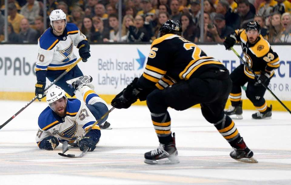 St. Louis Blues' David Perron, left, dives to