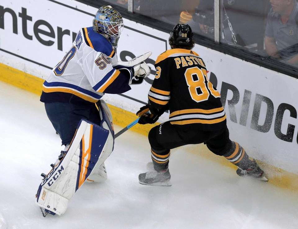 St. Louis Blues goaltender Jordan Binnington, left, and