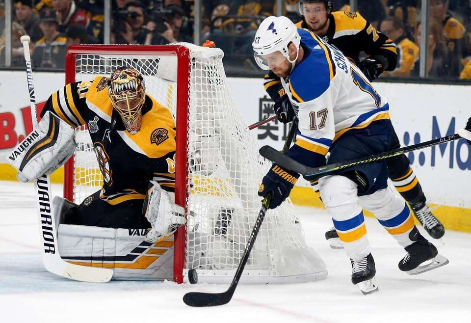 St. Louis Blues' Jaden Schwartz, right, carries the