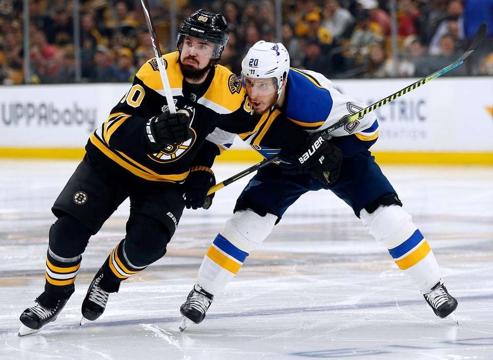 St. Louis Blues' Alexander Steen, right, defends against