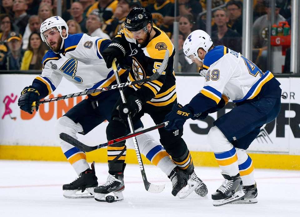 St. Louis Blues' Joel Edmundson, left, and Ivan