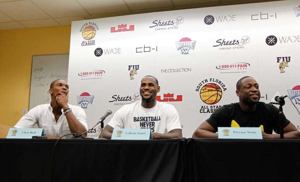 MIAMI, FL - OCTOBER 08: (L-R) Chris Bosh,