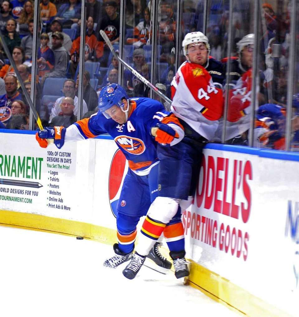 Brian Rolston of the Islanders sends Erik Gudbranson