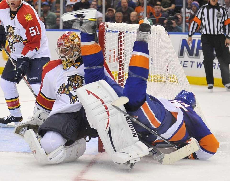 Matt Martin of the Islanders flips over the