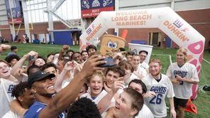 Giants running backSaquon Barkley, in partnership with Dunkin',