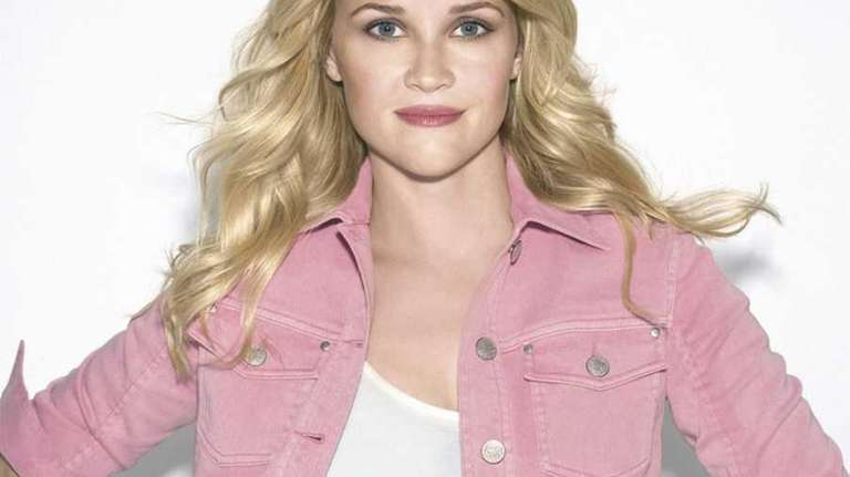 Reese Witherspoon wears Avon's stretch cotton denim jacket,