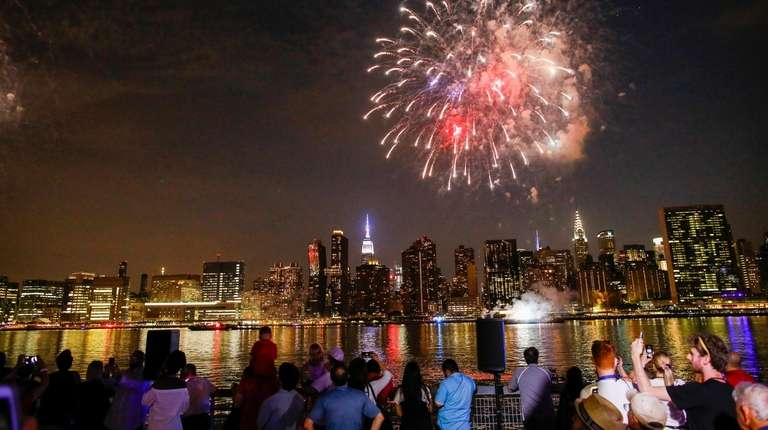 People watch the Macy's Fourth of July Fireworks