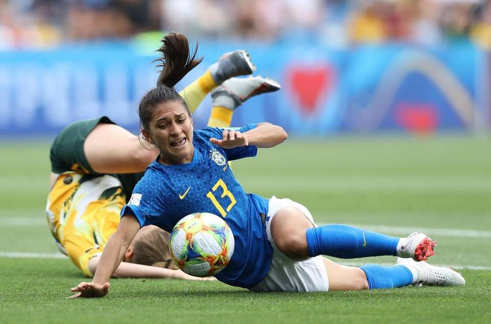 Leticia Santos of Brazil is fouled by Elise