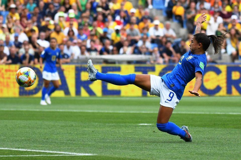 Brazil's forward Debinha fives for the ball during