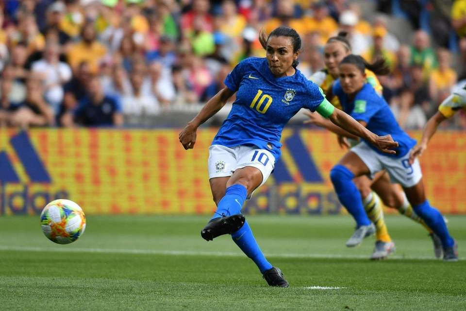 Brazil's forward Marta hits and scores a penalty