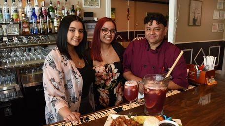 Juan Alvarado with daughters Emily, 24, left, and