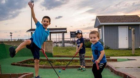 George Patsos of West Islip plays mini golf