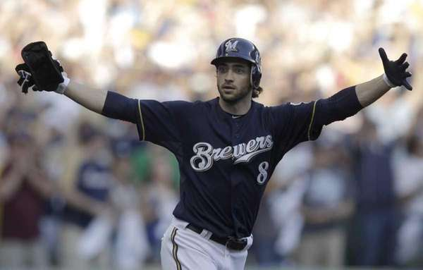 Milwaukee Brewers' Ryan Braun reacts after hitting a