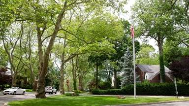 A 30-foot-tall flagpole at the corner of Manhasset