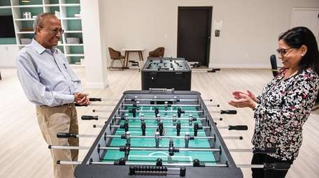 Drs. Sushil and Prem Sagar play a game