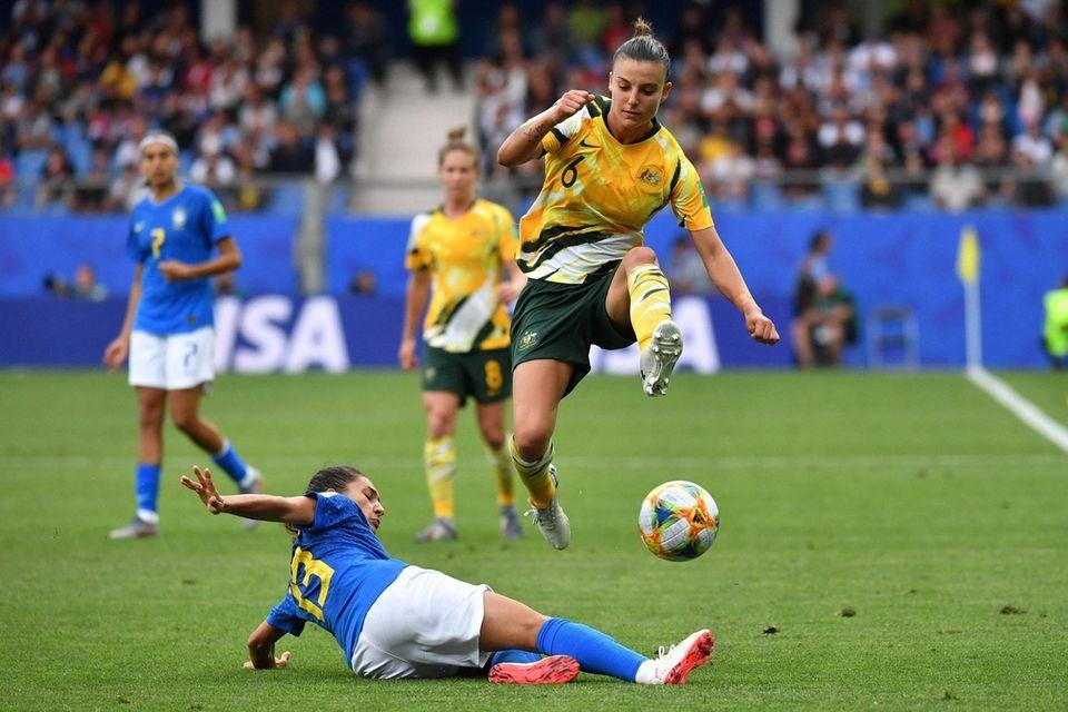 Brazil's defender Leticia Santos (down) tackles Australia's midfielder