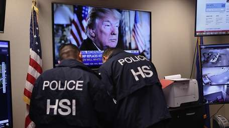 Homeland Security Investigations ICE agents work in a