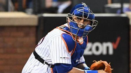 New York Mets catcher Wilson Ramos looks for