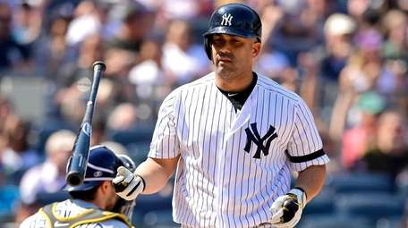 Kendrys Morales of the Yankees reacts after drawing