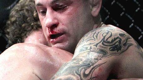 Frankie Edgar, right, fights Gray Maynard in the