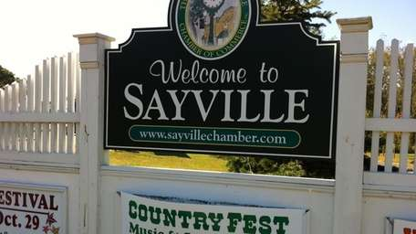 A sign welcomes visitors to Sayville. (Oct. 9,