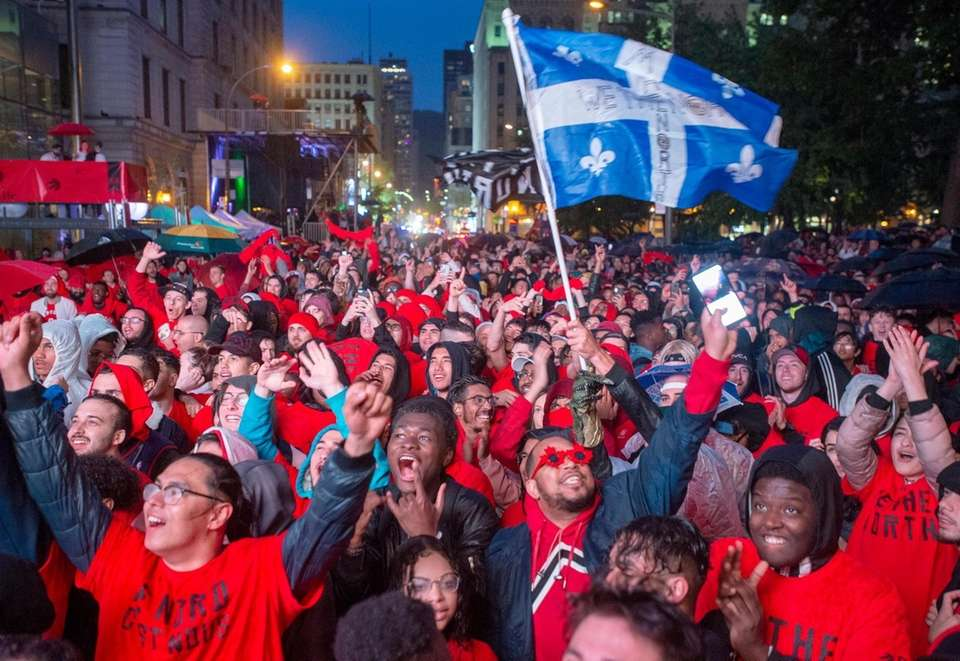 Toronto Raptors fans watch the broadcast of Game