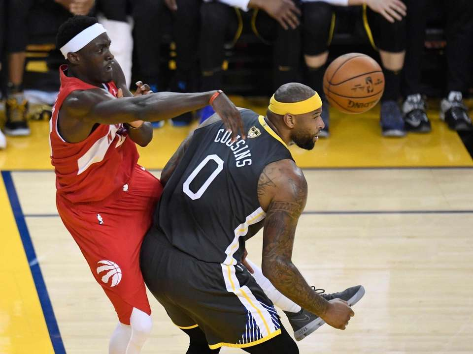 Golden State Warriors center DeMarcus Cousins (0) defends