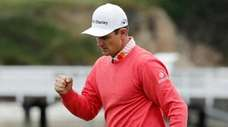 Justin Rose reacts after making a birdie on