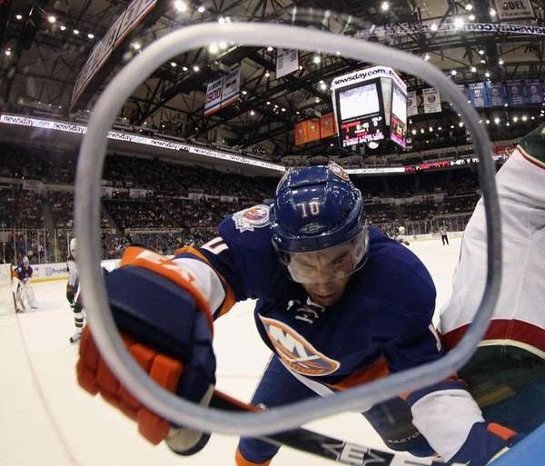 Mike Mottau of the New York Islanders checks