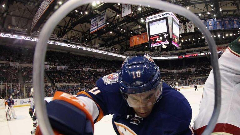 Mike Mottau of the New York Islanders checks